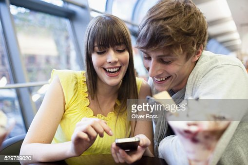 Young couple reading a text message : Stockfoto