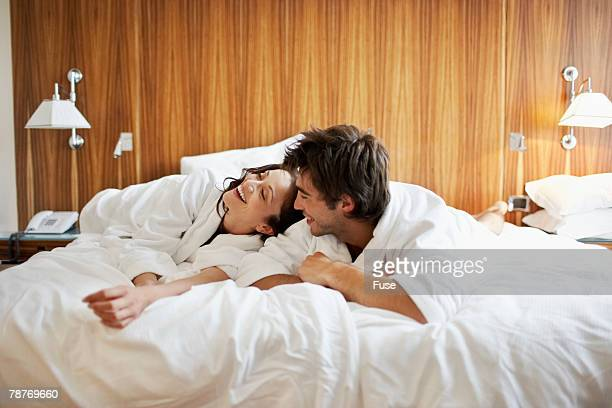Young Couple Relaxing in Bed