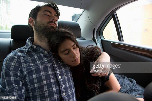 Young couple relaxing in car