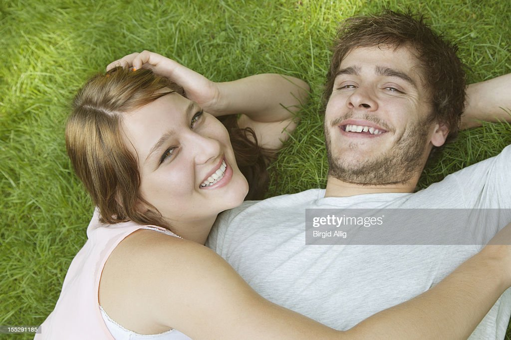 Young couple relaxing in garden : Stock Photo