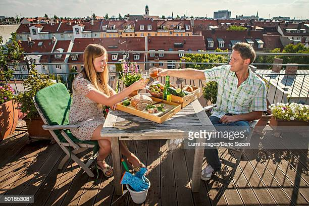 Young Couple Relaxing On Balcony, Munich, Bavaria, Germany, Europe