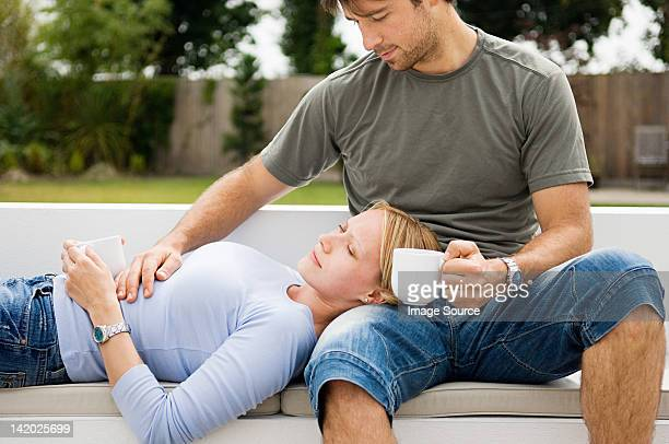 Young couple relaxing outdoors with coffee