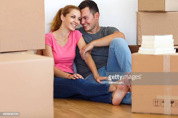 Young couple resting from moving into a new  home