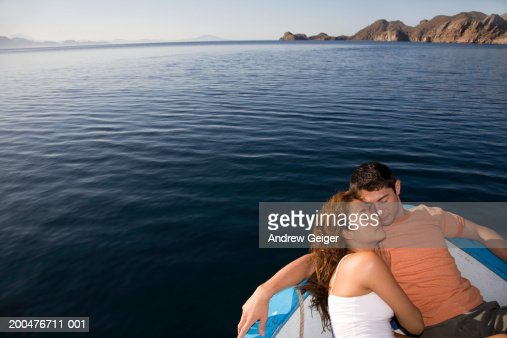Young couple resting in bow of boat : Stock Photo