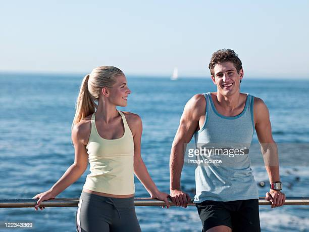 Young couple resting on railings