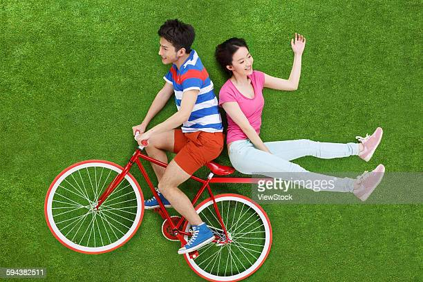 Young couple riding bicycle