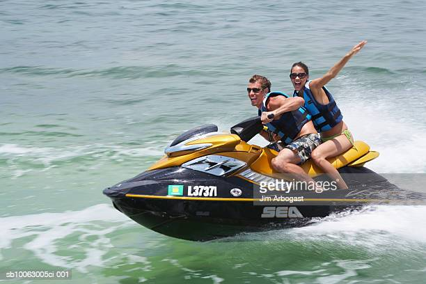 Young couple riding jet boat