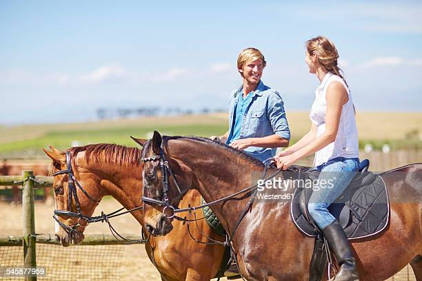 Young couple riding on the countryside