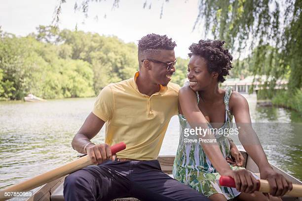 Young couple rowing on lake in Central Park, New York City, USA