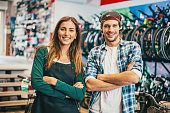Young couple running a bike shop