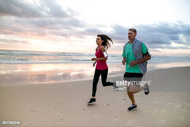 Young couple running at early morning