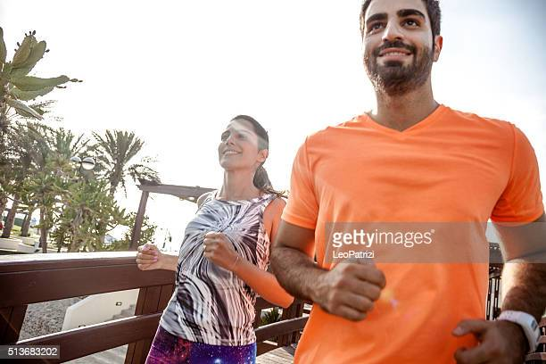 Young couple running - Fitness and exercising in Dubai