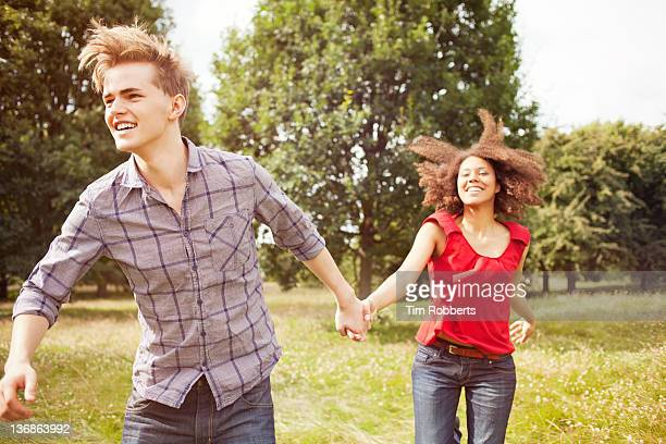 Young couple running in countryside.