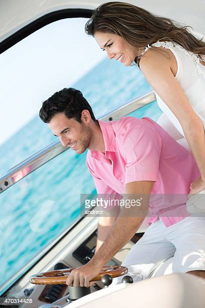 Young couple sailing on a yacht