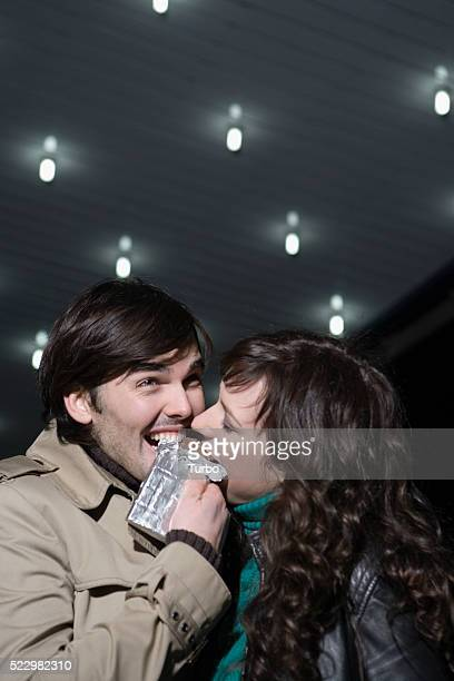 Young Couple Sharing Chocolate Bar