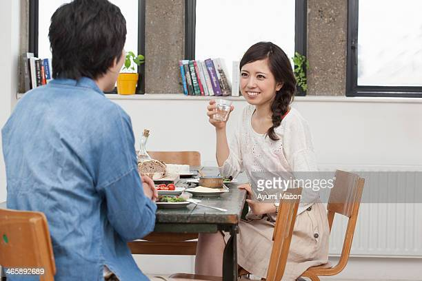 Young couple sharing meal at table