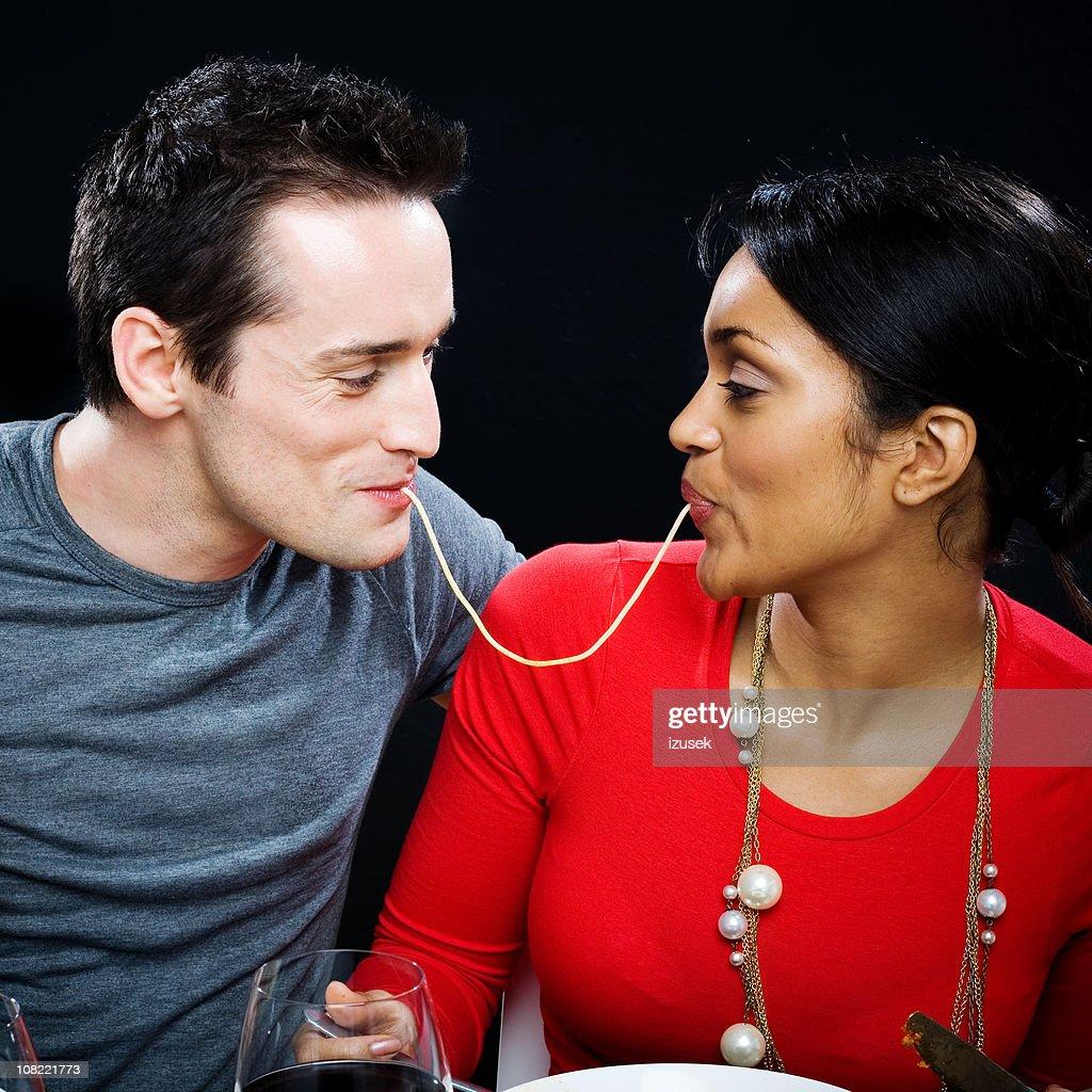 Young Couple Sharing Spaghetti : Stock Photo