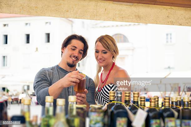 young couple shopping for olive oil