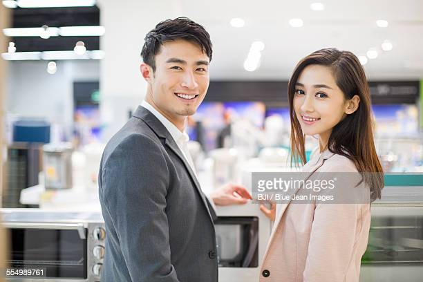Young couple shopping in electronics store