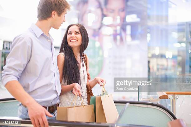 Young couple shopping in mall