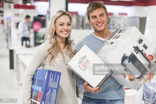Young couple shopping kitchen equipment