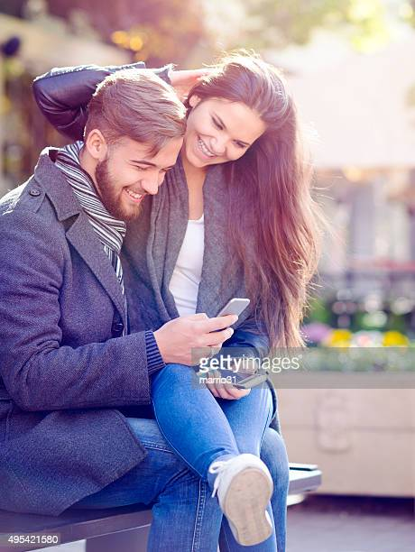 Young couple shopping online with smartphone