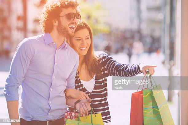 Young Couple Shopping Together in a city.