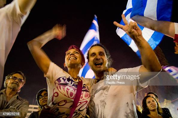 A young couple shouts slogans during the demonstration People gathered in Syntagma Square to celebrate the 'No' result that gives them hope to...