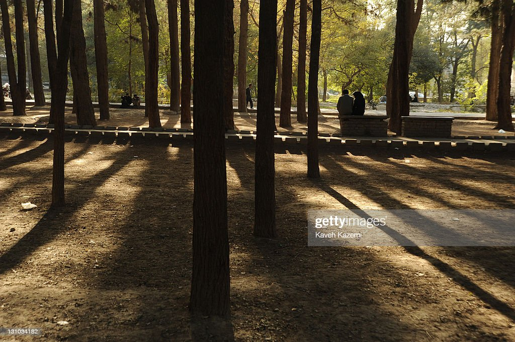 A young couple sit under tree shades in the quiet atmosphere of Shahr-e Now park on October 18, 2011 in Kabul, Afghanistan.