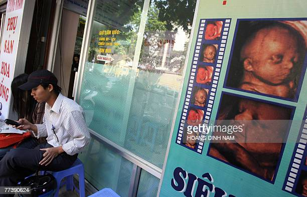 A young couple sits waiting outside a feotus ultrasound imaging service at a private medical practise in Hanoi 18 October 2007 Many Vietnamese people...