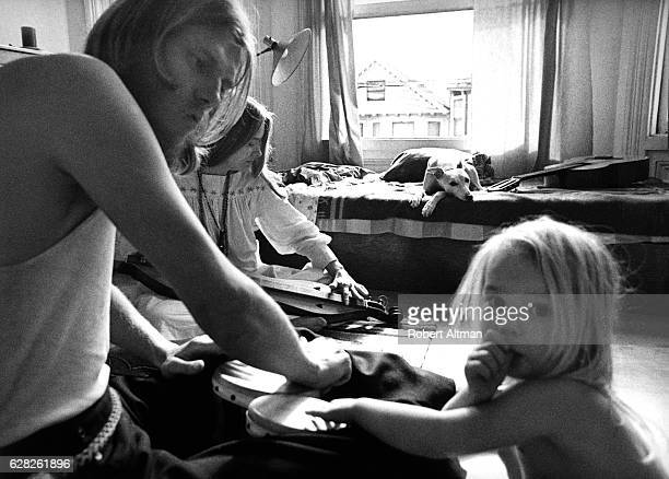 A young couple sits with their son and dog 'Whippet' in their home circa 1970 in the neighborhood of Noe Valley in San Francisco California