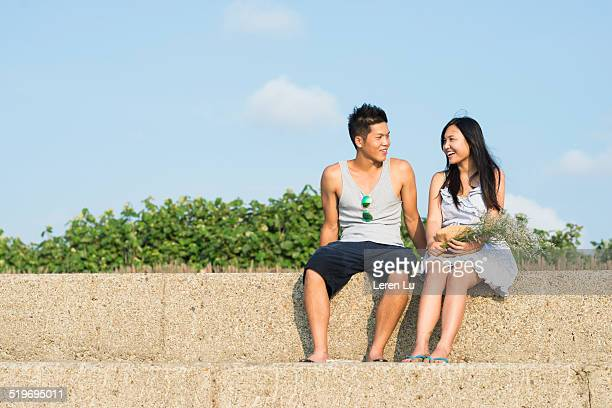 Young couple sitting and talking to each other.