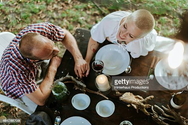 Young couple sitting at garden table
