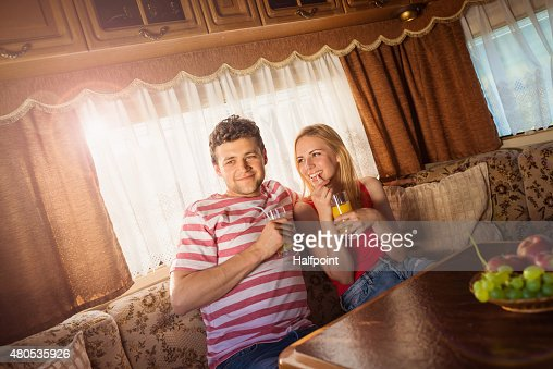 Young couple sitting in a camper van : Stockfoto