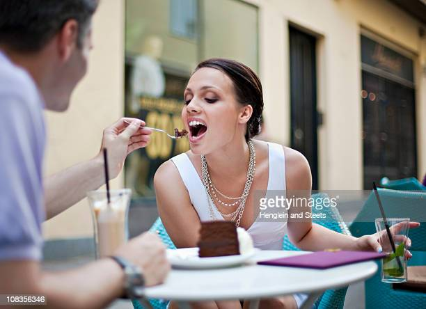 Young couple sitting in outdoor caf