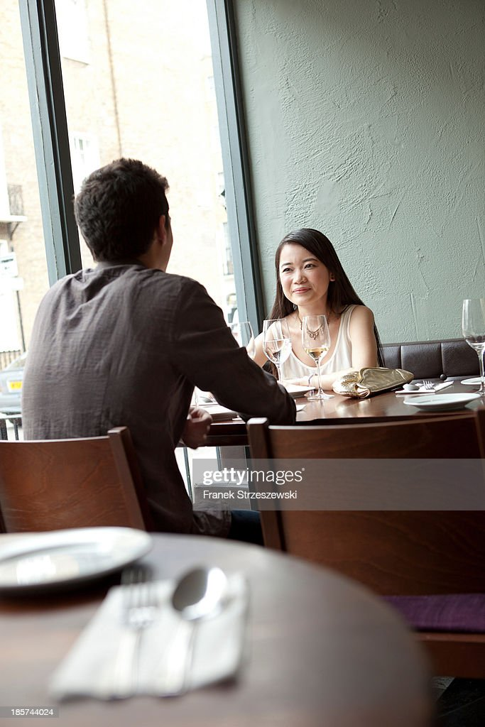 Young couple sitting in restaurant : Stock Photo