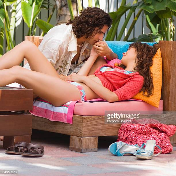 Young couple sitting on a couch and romancing