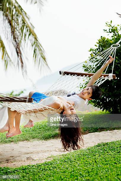 Young Couple Sitting on a Hammock
