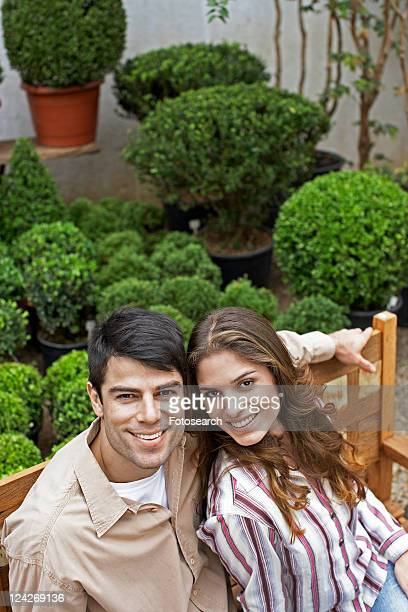 Young couple sitting on bench (high angle view)