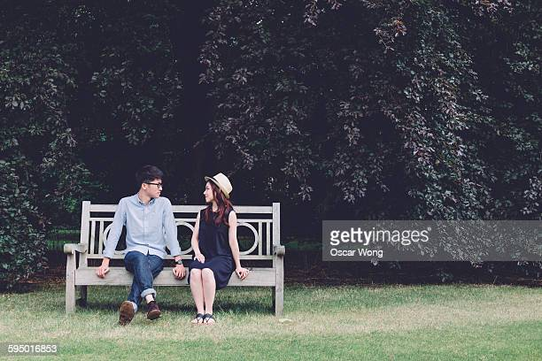 Young couple sitting on bench
