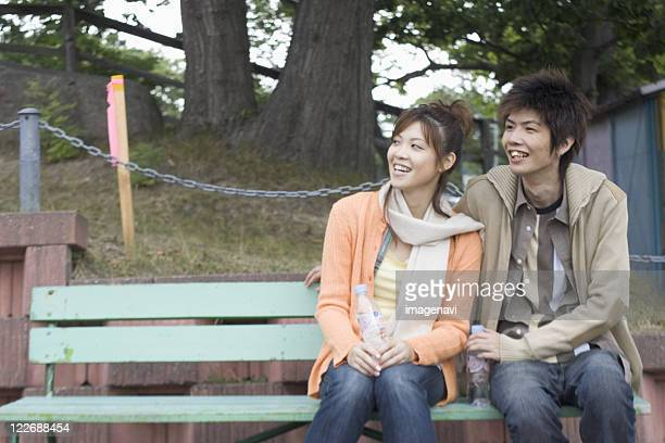 Young couple sitting on the bench