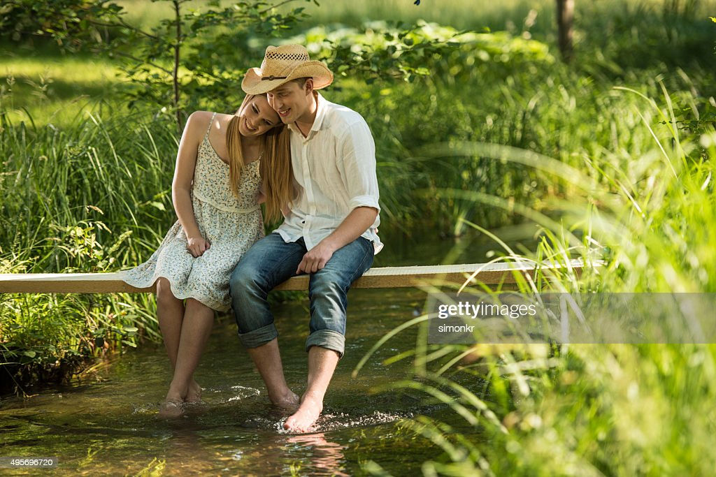 Young couple sitting on wood in forest