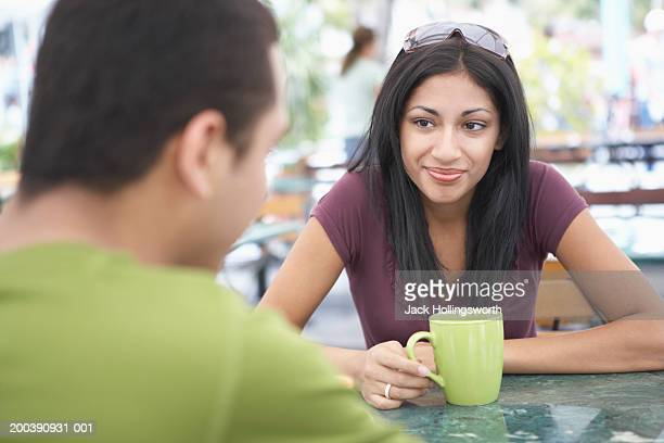 Young couple sitting together at a cafe