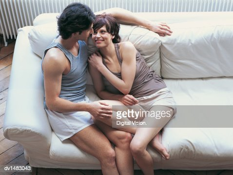 Young Couple Sitting Together on a Sofa