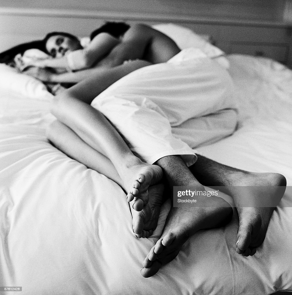 Young couple sleeping on a bed (black and white) : Stock Photo