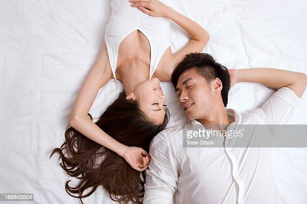 asian man laying stock photos and pictures getty images. Black Bedroom Furniture Sets. Home Design Ideas