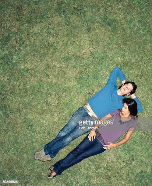 Young couple sleeping outdoors