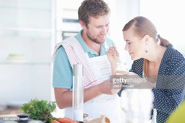 Young couple smelling ingredients