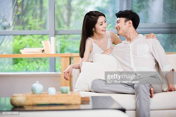 Young couple smiling at each other