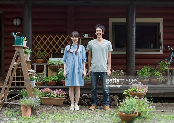 Young couple smiling at garden
